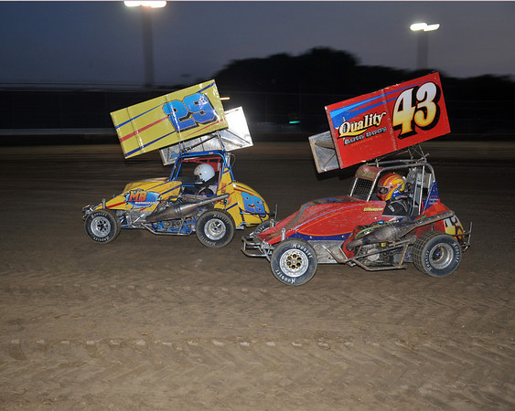 Lee Nardelli and Justin Stillwaggon race to the checkered flag on Friday May 25th.  This photo appeared in the May 29th edition of AARN.