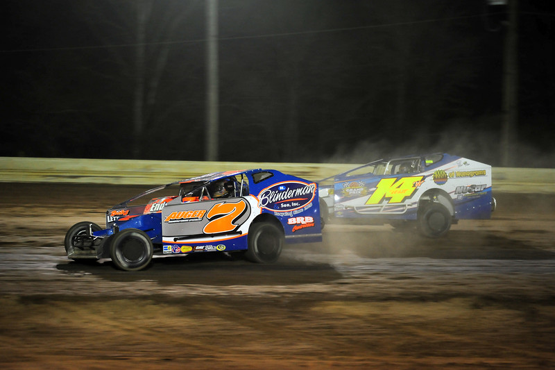 Rick Laubach gets by Ryan Watt late in the race to steal a win at Bridgeport Speedway on 4/26.   This photo appeared in the April 29 edition of AARN.