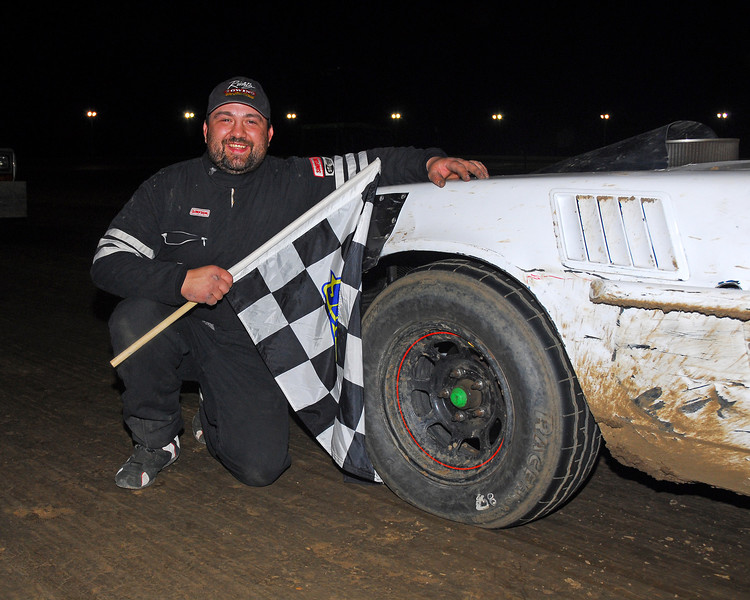 Jeremy Doerr in Outlaw Stock Victory lane.  This photo from the May 3rd. race appeared in the 5/6 Area Auto Racing News.