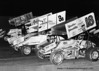 WoO Outlaws start Doug Wolfgang, George Bishoff, Danny Smith (?) and Steve Kinser in the very early 80s.