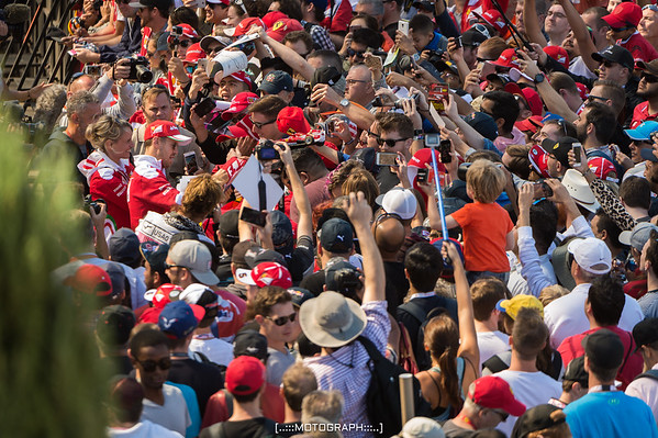 Scuderia Ferrari's Sebastian Vettel takes time to meet the Tifosi