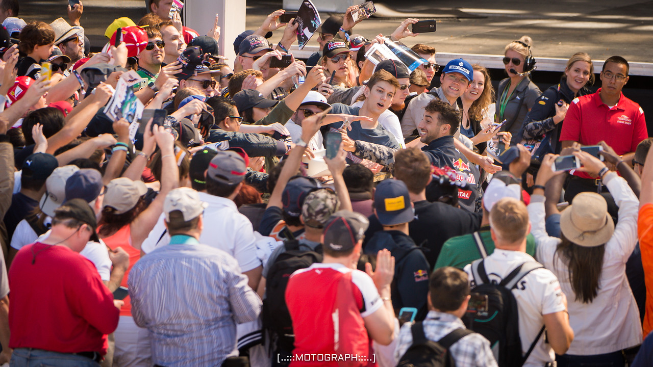 Team Red Bull Racing's Daniel Ricciardo returns a borrowed cowboy hat to one of his adoring fans