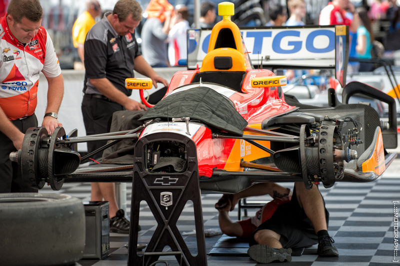 Workers tune the Dallara chassis of EJ Viso's Citgo Chevrolet.