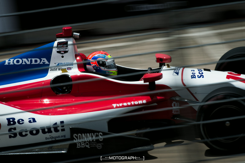 Team Dale Coyne Racing pilot Justin Wilson screams out of Turn 10