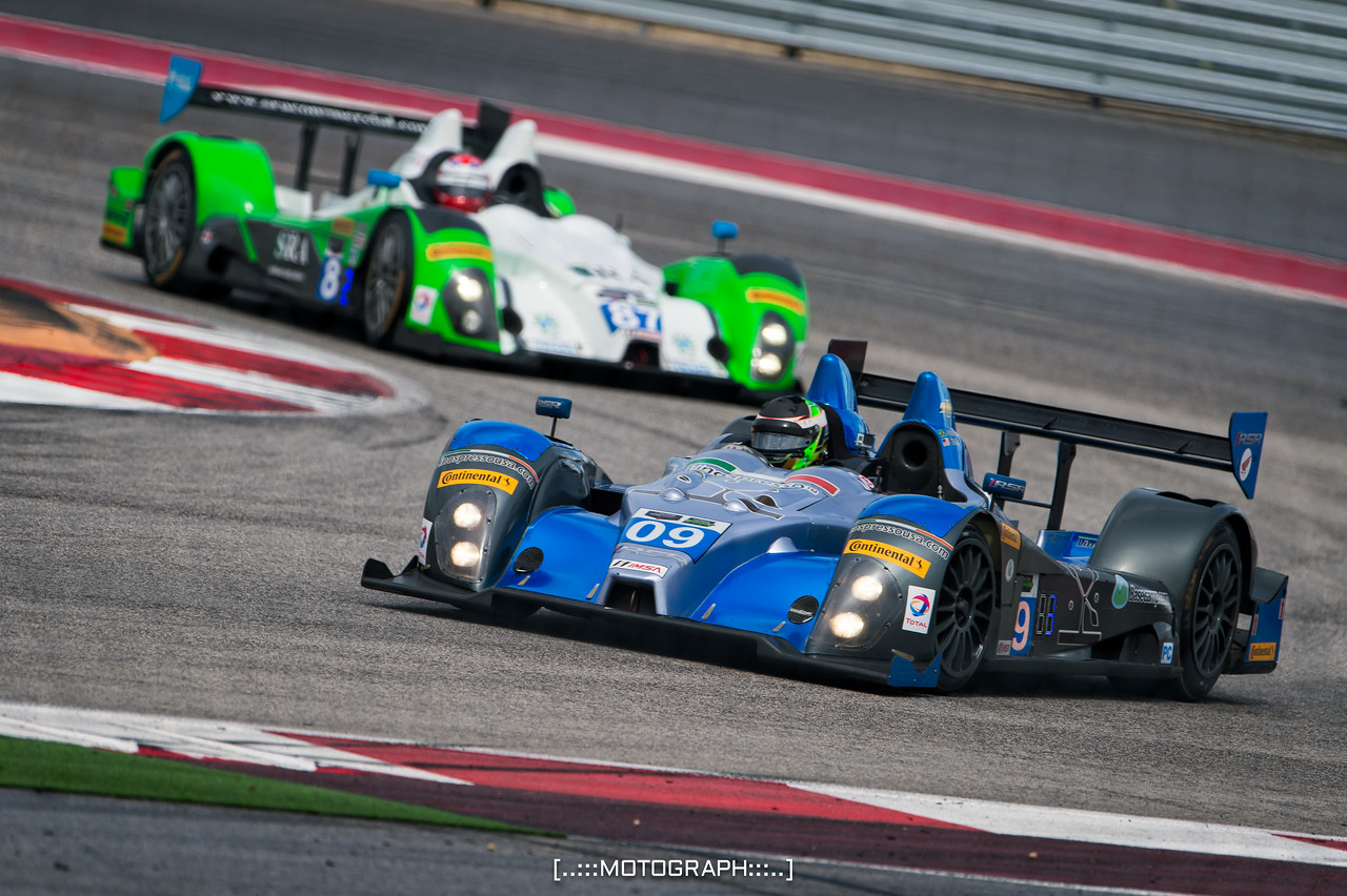 The PC entries of RSR Racing and BAR1 Motorsports  accelerate out of Turn 13