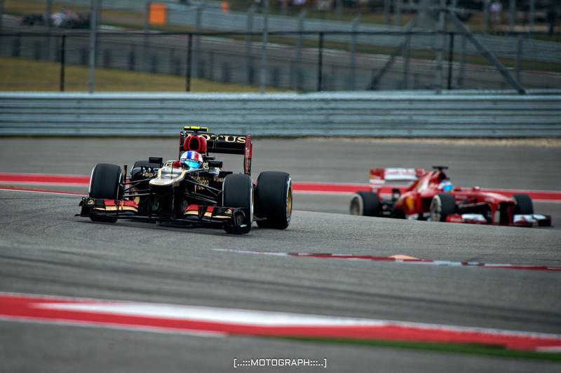 Lotus pilot Romain Grosjean leads Ferrari's Fernando Alonso through turn nine on Sunday