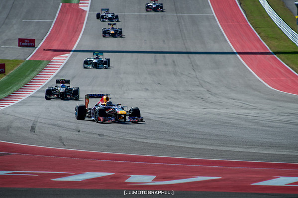 Four time F1 champion Sebastian Vettel leads the field into turn 11 on the first lap of the 2013 US Grand Prix