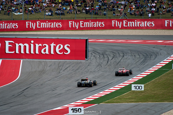 Ferrari's Felipe Massa enters turn 11 ahead of Lotus driver Romain Grosjean