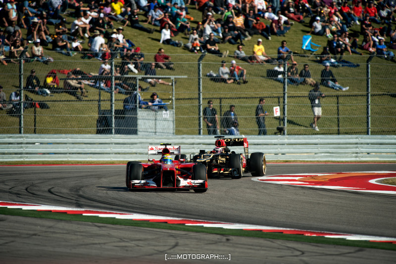 Felipe Massa accelerates out of turn 19 in front of Lotus driver Romain Grosjean during FP2