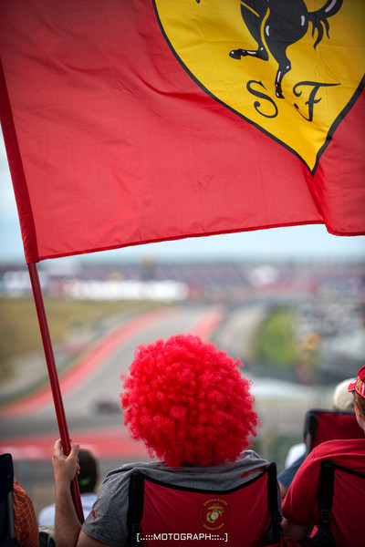 One of the countless members of Ferrari's Tifosi flying the colors of the prancing pony