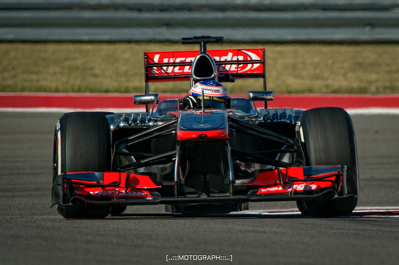 Jenson Button slings through turn 20 during FP2