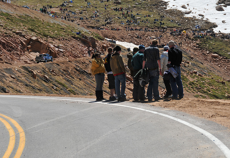 Spectators on the corner where Bobby Regester lost control and went off the mountain.