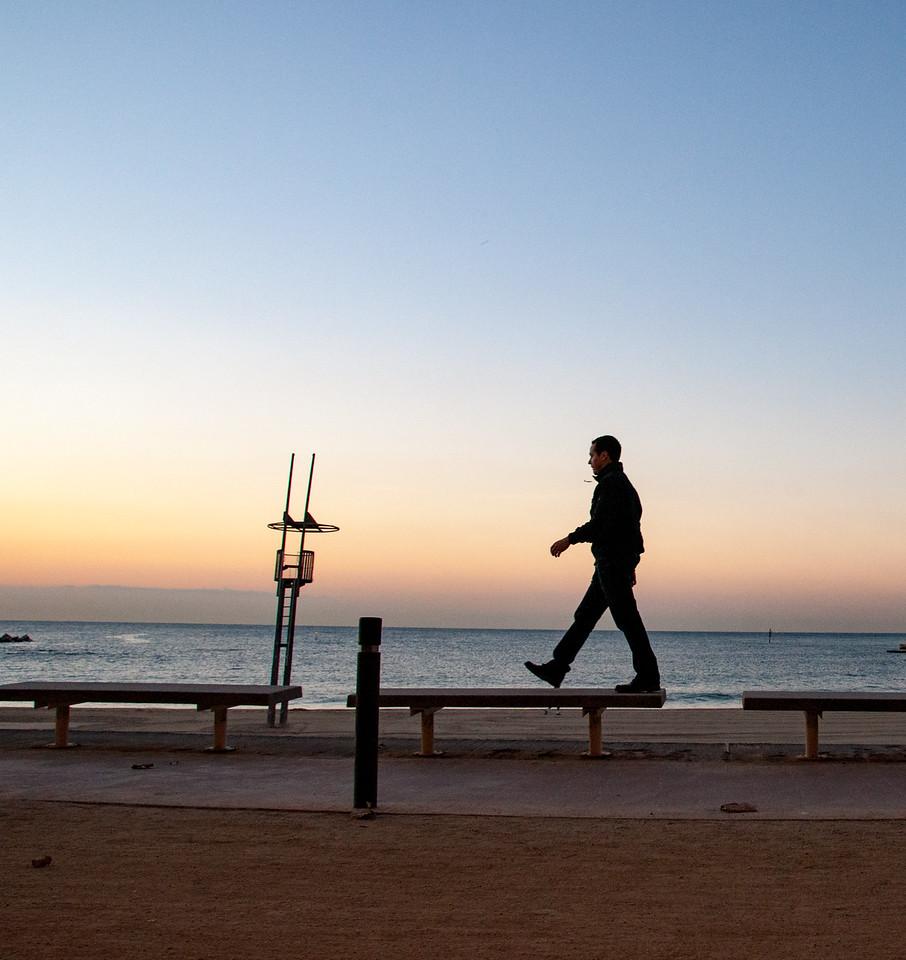Matt walking at the beach at sunrise