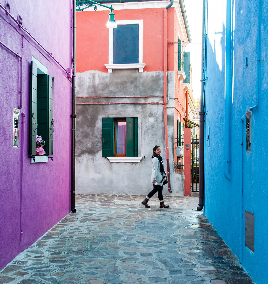 The island of Burano is known for its colorful buildings and silk making.