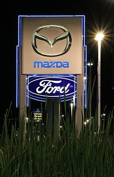 Signs on dealership row