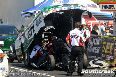 Fifteen time NHRA funny car champion John Force waits for his quarter final race during the VisitMyrtleBeach.com NHRA Four-Wide Nationals Finals at zMax Dragway, Concord, NC.