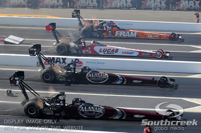 The top fuel dragsters race in the finals during the VisitMyrtleBeach.com NHRA Four-Wide Nationals Finals at zMax Dragway, Concord, NC.