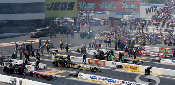 The top fuel dragsters prepare for a semi-final race during the VisitMyrtleBeach.com NHRA Four-Wide Nationals Finals at zMax Dragway, Concord, NC.