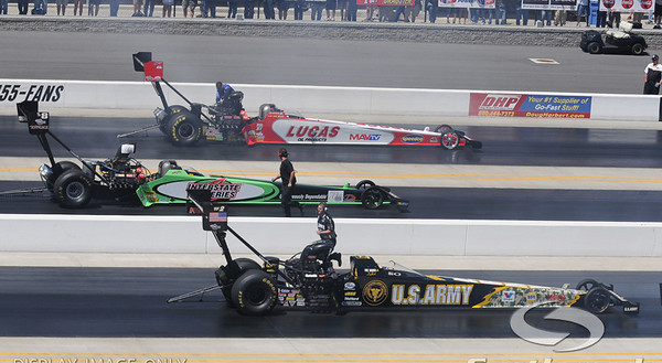 Top fuel dragster drivers Tony Schumacher, Steve Torrence, and Shawn Langdon prepare for their semi-final runs during the VisitMyrtleBeach.com NHRA Four-Wide Nationals Finals at zMax Dragway, Concord, NC.