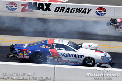 Pro stock driver Ron Krisher does a burn-out during the VisitMyrtleBeach.com NHRA Four-Wide Nationals Finals at zMax Dragway, Concord, NC.