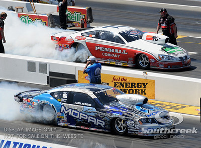 Pro stock driver's Allen Johnson and Mike Edwards do their burn-outs during the VisitMyrtleBeach.com NHRA Four-Wide Nationals Finals at zMax Dragway, Concord, NC.