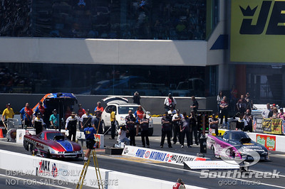 Top alcohol funny car drivers Brent Henry and Melinda Green-King line up for their round 2 elimination race during the VisitMyrtleBeach.com NHRA Four-Wide Nationals Finals at zMax Dragway, Concord, NC.