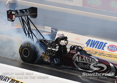 Top fuel dragster driver Larry Dixon does a burnout during the VisitMyrtleBeach.com NHRA Four-Wide Nationals Finals at zMax Dragway, Concord, NC.