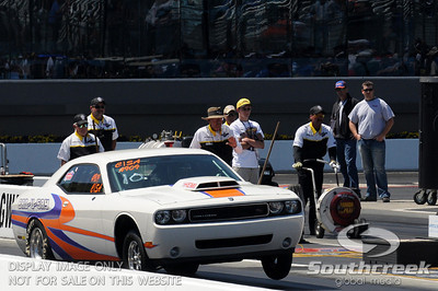 A Dodge Challenger races during the VisitMyrtleBeach.com NHRA Four-Wide Nationals Finals at zMax Dragway, Concord, NC.