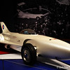 """GENERAL MOTORS FIREBIRD XP-21 (1953)<br /> <br /> Harley J. Earl (American, 1893-1969), designer<br /> Robert F. """"Bob"""" McLean and GM Styling Section staff, designers<br /> General Motors Corporation, American, founded 1908, manufacturer<br /> Courtesy of General Motors Heritage Center, Warren, Michigan <br /> <br /> """"The Firebird XP-21 was the first gas turbine-powered car built and tested in the United States. At the 1954 Motorama, General Motors made it clear this was a design study created to determine the practicality of the gas turbine for use in future vehicles. Harley Earl, GM's styling chief, made the decision to initiate the development of the Firebird I in the styling department rather than the engineering department. He took styling cues from the Douglas F4D Skyray jet, and the car's """"needle"""" nose, swept-back wings, vertical tailfin, and plastic bubble top cockpit reflected this inspiration. As it was described in the press at the time, """"the first impression one gets of the Firebird is that it is a jet fighter on four wheels – an impression that prevails even while the car is standing still."""" <br /> <br /> """"Although the Firebird I's lofty power output was intriguing, the gas turbine engine could not provide economical performance. Besides its impractical single-seater design, its jet engine was too loud, its exhaust temperature at the tailpipe was 1,000 degrees Fahrenheit and its low fuel economy was unacceptable. But it was a Motorama sensation, and two successors followed at later Motoramas: the Firebird II in 1956 and the Firebird III in 1959. The Firebird series symbolized the era's obsession with outer space and air travel.""""<br /> <br /> Reprinted information from here: <a href=""""http://www.high.org/Art/Exhibitions/Dream-Cars.aspx"""">http://www.high.org/Art/Exhibitions/Dream-Cars.aspx</a><br /> <br /> High Museum of Art<br /> 1280 Peachtree Street, N.E. <br /> Atlanta, GA 30309<br /> Official website: <a href=""""http://www.high.org"""">http://www.high.org</a"""