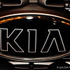 """KIA"" logo<br /> <br /> ""The car trip can draw the family together, as it was in the days before television when parents and children actually talked to each other."" ~ Andrew H. Malcolm"