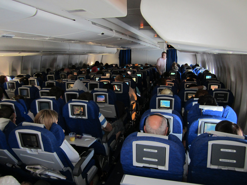 747 somewhere over Greenland/Canada. View from the back door of the last compartment.<br /> My seat was at the front of this section on the seat just to the right of the blue curtain on the left.<br /> No-one in front to lean back, some extra legroom. Bliss.
