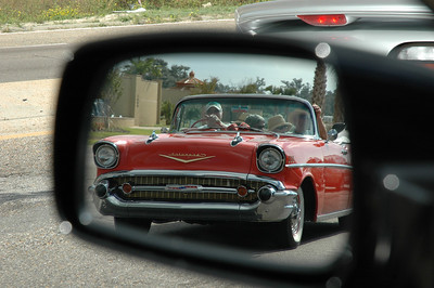I have fallen in love with rear view mirror shots, I admit it.