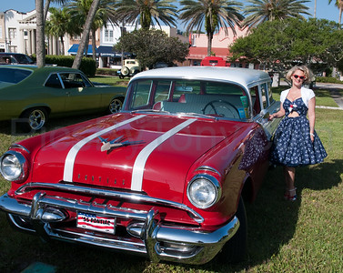 Woman with her 55 Buick at Spirit  of Automobile in Daytona Beach, FL on May 16, 2015