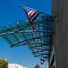 Awning is comprised of automobile windshields flanked by the American and French flags.