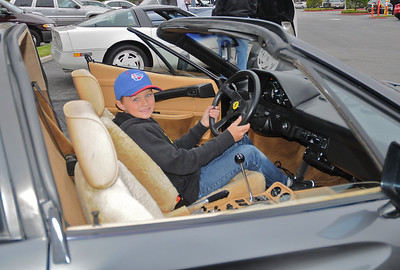 Sam Magnusen trys out Larry's Ferrari for size, he wants to know where the keys are!