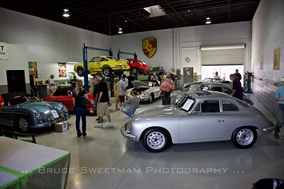 A 1965 Porsche 356 SC Sunroof Coupe heads the line at Willhoit Restoration Friday Open House.