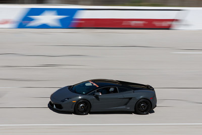 A car dealership in Houston, Lamborghini Houston, attended the Lamborghini Festival bringing a group of Lamborghini Gallardo's out to Texas World Speedway. I had the chance to witness and photograph the event. This is one of those cars running across the finish line at well over 100mph.