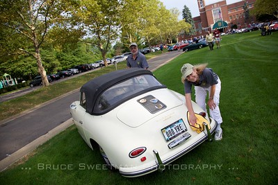 "Tom & Brenda Moore wipe down their 1959 356A Cabriolet. ""We've driven her to every 356 Holiday since our 2012 purchase."""