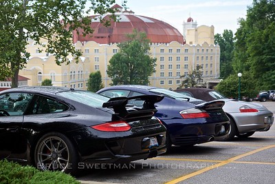 The West Baden Springs Hotel looms behind Porsches.