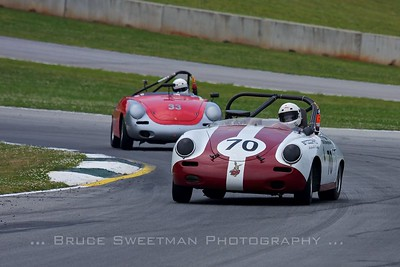 A couple of Porsche 356s drift through turn 12.