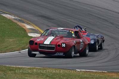 A 1970 Camaro powers through turn 1.