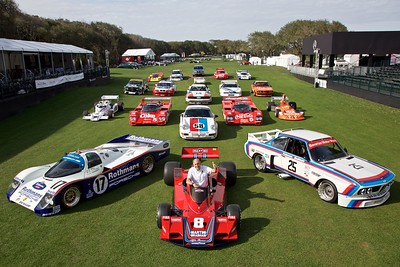2016 Amelia Island Concours d'Elegance Honoree Hans Stuck sits in the Alfa Romeo-powered Brabham BT45B surrounded by the race cars of long career.