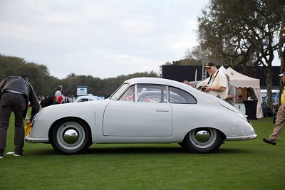 Jeff Zwart dries the morning dew off his 1949 Porsche 356 Gmünd Coupe on show day.