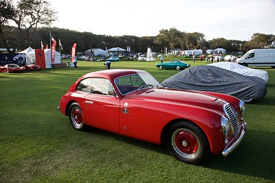 A 1950 Maserati A6 1500 PF takes to the field the night before the show.