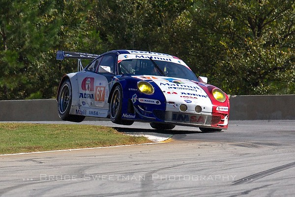 The IMSA Performance Malmut Porsche GT3 RSR takes the short way around turn 3.