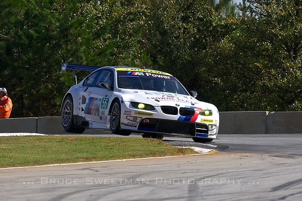 The #56 BMW M3 does the turn 3 hop.