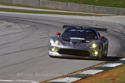 The #91 SRT Motorsports Viper GTSR carves turn 12  during GT qualifying.