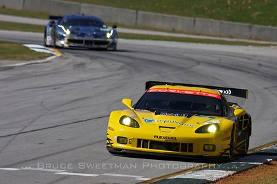 The #3 Corvette C6 ZR1 leads a Ferrari F458 Italia though turn 12 during GT qualifying.