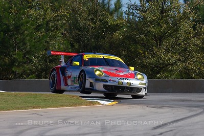 The #45 Flying LIzard Motorsports 911 GT3 RSR Porsche negotiates turn 3.