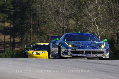 The #01 Extreme Motorsports Ferrari F458 Italia crests the hill above turn 1.